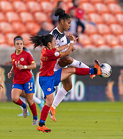 Lixy Rodriguez #12 of Costa Rica fights for the ball with Aldrith Quintero #10 of Panama