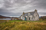 Isle of Lewis, Outer Hebridies Scotland:<br /> Abandoned isolated house wtih turquoise door