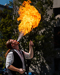 WATERBURY, CT 073021JS13 Daniel GreenWolf entertains the crowd during his fire-breathing magic show outside the Silas Bronson Library as part of Harry Potter Day festivities in downtown Waterbury on Friday. <br />  Jim Shannon Republican American