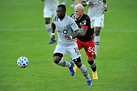 WASHINGTON, DC - NOVEMBER 8: Zachary Brault-Guillard #15 of Montreal Impact battles for the ball with Erick Sorga #50 of D.C. United during a game between Montreal Impact and D.C. United at Audi Field on November 8, 2020 in Washington, DC.