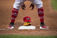Orem Owlz third baseman Kevin Maitan (9) picks up his hat and glove between innings of a Pioneer League game against the Ogden Raptors at Home of the OWLZ on August 24, 2018 in Orem, Utah. The Ogden Raptors defeated the Orem Owlz by a score of 13-5. (Zachary Lucy/Four Seam Images)