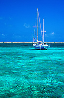 Sailboat and tropical ocean water, Ambergris Caye, Belize