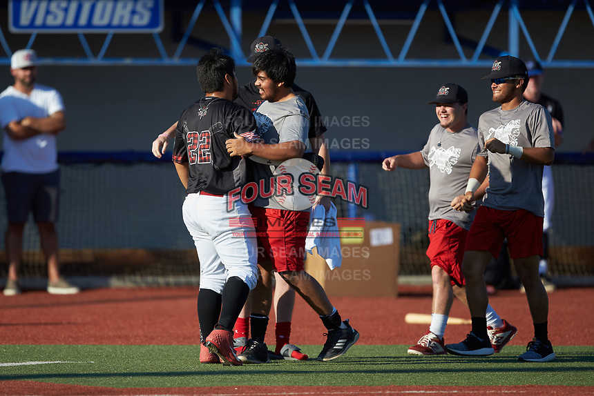 Corey Armstrong (22) (Auburn University at Montgomery) of the Guilford Lumberkings is congratulated by teammates after completing his round in the Old North State League All-Star Home Run Derby at Hooker Field on July 11, 2020 in Martinsville, VA.  (Brian Westerholt/Four Seam Images)