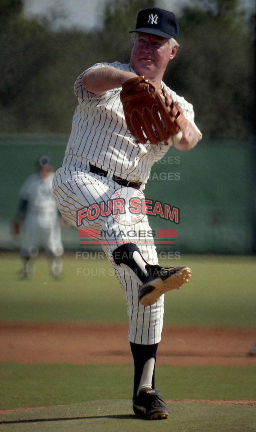 Whitey Ford throws a pitch during the Mickey Mantle-Whitey Ford Fantasy Camp circa November 1989 at Fort Lauderdale Stadium in Ft. Lauderdale, Florida.  (MJA/Four Seam Images)