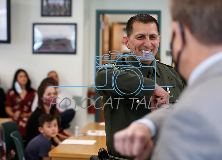 Lt. Daniel Gonzales greets Mayor Bob Crowell before a promotion ceremony at Carson City Sheriff's Office, in Carson City, Nev., on Thursday, July 2, 2020. <br /> Photo by Cathleen Allison