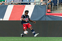 FOXBOROUGH, MA - AUGUST 8: DeJuan Jones #24 of New England Revolution crosses the ball during a game between Philadelphia Union and New England Revolution at Gillette Stadium on August 8, 2021 in Foxborough, Massachusetts.