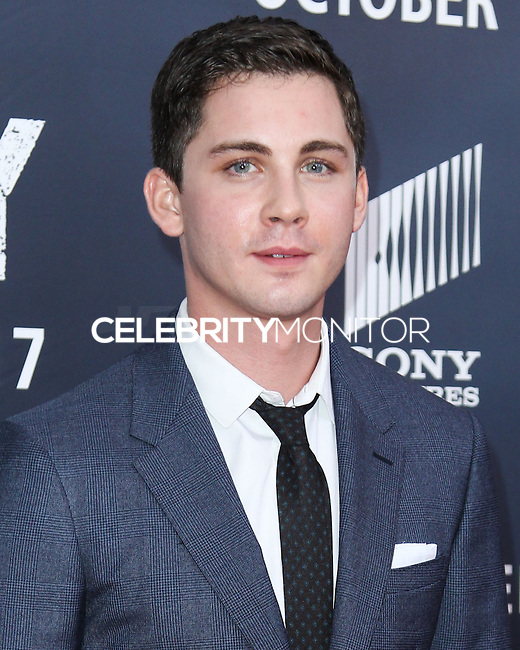 WASHINGTON, DC, USA - OCTOBER 15: Logan Lerman arrives at the Washington DC Premiere Of Sony Pictures' 'Fury' held at The Newseum on October 15, 2014 in Washington, DC, United States. (Photo by Jeffery Duran/Celebrity Monitor)
