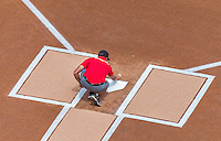 23 August 2015: A Washington Nationals Grounds-crew member puts the finishing touches on home plate prior to a game against the Milwaukee Brewers at Nationals Park in Washington, DC. The Nationals defeated the Brewers 9-5 in the third game of their 3-game weekend series. Mandatory Credit: Ed Wolfstein Photo *** RAW (NEF) Image File Available ***
