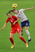 18th February 2021, Orlando, Florida, USA;  Canada forward Evelyne Viens (9) battles with United States defender Becky Sauerbrunn (4) during a SheBelieves Cup game between Canada and the United States on February 18, 2021 at Exploria Stadium in Orlando, FL.