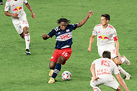 FOXBOROUGH, MA - MAY 22: DeJuan Jones #24 of New England Revolution dribbles during a game between New York Red Bulls and New England Revolution at Gillette Stadium on May 22, 2021 in Foxborough, Massachusetts.