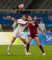 USWNT midfielder (7) Shannon Boxx fights for the ball with Canadian forward (15) Kara Lang while playing at Shanghai Stadium.  The US defeated Canada, 2-1, in extra time and advanced to the semifinals during the 2008 Beijing Olympics in Shanghai, China.