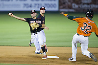Christian Stringer (8) of the Kannapolis Intimidators turns a double play as K.J. Woods (32) of the Greensboro Grasshoppers slides into second base at CMC-Northeast Stadium on June 11, 2015 in Kannapolis, North Carolina.  The Intimidators defeated the Grasshoppers 7-6.  (Brian Westerholt/Four Seam Images)