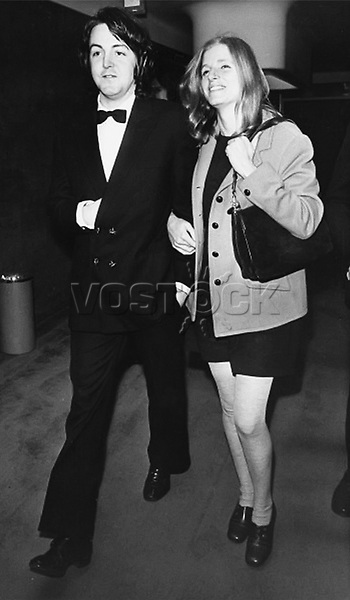 """Beatle Paul McCartney and girlfriend Linda Eastman arriving at the Odeon, St. Martin's Lane for the film premiere of """"Isadora"""" in London, May 3, 1969."""