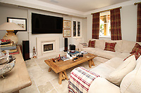 BNPS.co.uk (01202) 558833. <br /> Pic: Bidwells/BNPS<br /> <br /> Pictured: Living room.<br /> <br /> Better than a gravy boat...<br /> <br /> A striking country house built by a bishop as a wedding gift for his son is on the market for offers over £2m.<br /> <br /> Dunbeg House sits in an incredible position on the bank of a loch with stunning panoramic water and mountain views.<br /> <br /> The impressive property not only includes the five-bedroom main house, but also a two-bedroom cottage that has been run as a successful holiday let and over four acres of woodland garden.