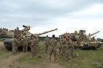 "American soldiers with Delta Company, 2nd Battalion, 7th Infantry Regiment, 1st Armored Brigade Combat Team, 3rd Infantry Division with M1A2 Abrams tanks prepare for the After Action Review following a tank training exercise practicing infiltration at the Drawsko Pomorskie Training Area in Poland on June 12, 2015.    NATO is engaged in a multilateral training exercise ""Saber Strike,"" the first time Poland has hosted such war games, involving the militaries of Canada, Denmark, Germany, Poland, and the United States."