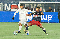 FOXBOROUGH, MA - NOVEMBER 1: Brandon Bye #15 of New England Revolution comes in to tackle Gelmin Rivas #20 of DC United during a game between D.C. United and New England Revolution at Gillette Stadium on November 1, 2020 in Foxborough, Massachusetts.