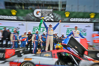 Christin Fittipaldi celebrates after climbing out of his race car in victory lane after winning the Rolex 24 at Daytona, Daytona International Speedway, Daytona Beach, FL, January 2014.  (Photo by Brian Cleary/www.bcpix.com)