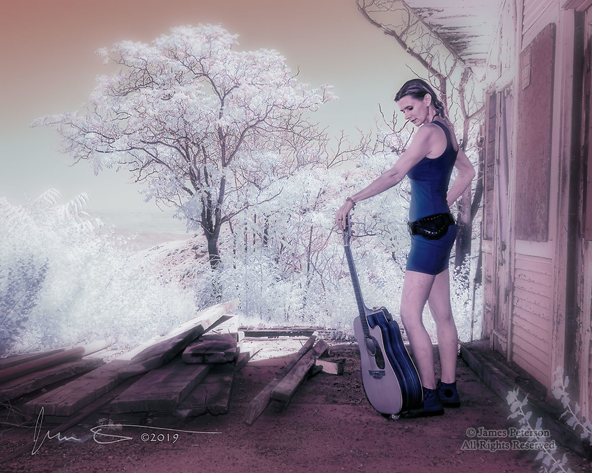 Facing A New World.  Winter Amy, lead singer and guitarist with her Sedona band The Fey, is also a fine photographer's model.  In this environmental portrait made in Jerome, Arizona, she's all set to head out and conquer a newly discovered infrared planet.  This image was captured during a recent workshop at Jerome's Red Bench Studio.<br /> <br /> Image ©2019 James D Peterson