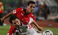 Egypt's Aly Mohamed (7) trips up Costa Rica's Diego Madrigal (11) during the FIFA Under 20 World Cup Round of 16 match between Egypt and Costa Rica at the Cairo International Stadium on October 06, 2009 in Cairo, Egypt.