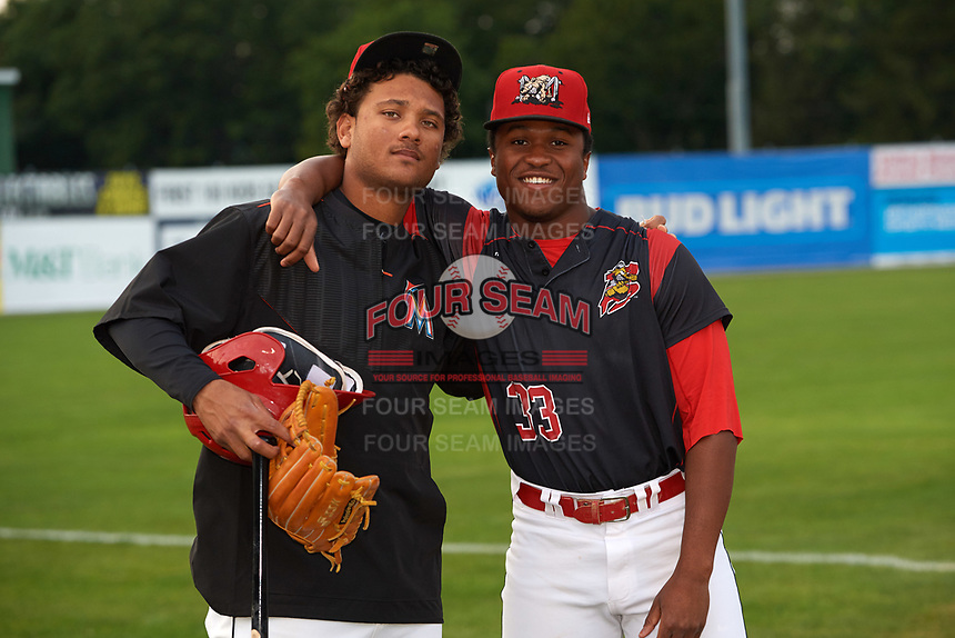 Batavia Muckdogs Ricardo Cespedes (left) and Terry Bennett (33) before a game against the Mahoning Valley Scrappers on August 29, 2017 at Dwyer Stadium in Batavia, New York.  Batavia defeated Mahoning Valley 2-0.  (Mike Janes/Four Seam Images)