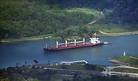 aerial photograph of the JS Phoenix bulk carrier transiting the Panama Canal, Panama accompanied by a tug boat | Fotografía aérea del granelero JS Phoenix que transita por el Canal de Panamá, Panamá acompañado de un remolcador