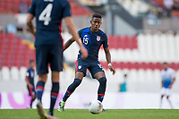 GUADALAJARA, MEXICO - MARCH 18: Andres Perea #15 of the United States chases down a loose ball during a game between Costa Rica and USMNT U-23 at Estadio Jalisco on March 18, 2021 in Guadalajara, Mexico.