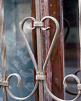 The metal protective bars in front of the window form a heart shape