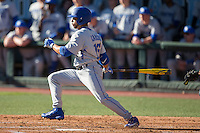 Marcus Carson (15) of the Kentucky Wildcats follows through on his swing against the North Carolina Tar Heels at Boshmer Stadium on February 17, 2017 in Chapel Hill, North Carolina.  The Tar Heels defeated the Wildcats 3-1.  (Brian Westerholt/Four Seam Images)