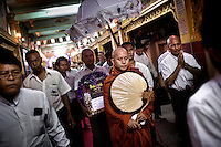 U Wirathu, the spiritual leader of the 969 Buddhist Nationalist movement, and his entourage leave after giving a sermon, at a monastery in Mandalay. U Wirathu is an abbot in the New Maesoeyin Monastery where he leads about 60 monks and has influence over more than 2,500 residing there. He travels the country giving sermons to religious and laypeople encouraging Buddhists to shun Muslim business and communities. /Felix Features