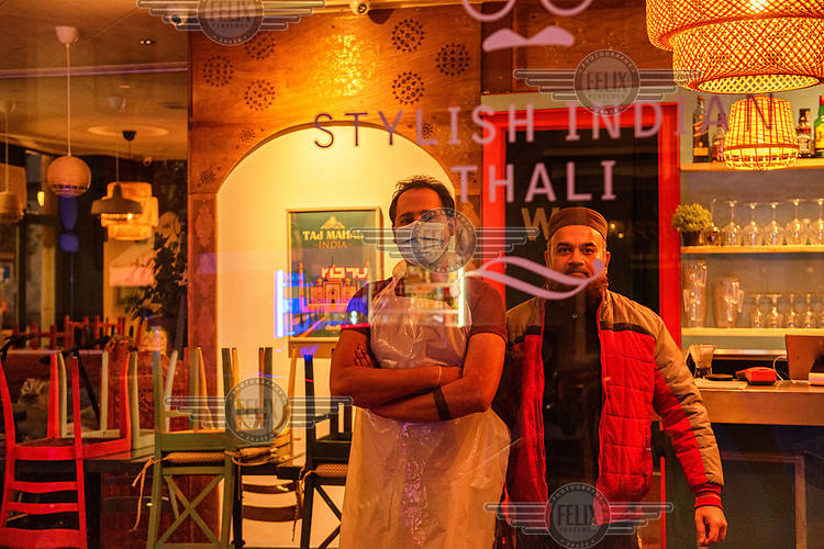 Staff at an Indian restaurant in Geneva's multi-cultural Paquis district that has switched to a take away delivery service during the second wave of the COVID-19 pandemic which saw eat-in restaurants and non-essential shops forced to close.