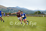 St Marys Darren Casey holds possession as Dromids Shane O'Conchubhair keeps the pressure on.