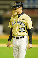 Wake Forest Demon Deacons head coach Tom Walter #32 coaches third base during the game against the Northwestern Wildcats at Gene Hooks Field on February 26, 2011 in Winston-Salem, North Carolina.  Photo by Brian Westerholt / Four Seam Images