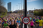 © Joel Goodman - 07973 332324 . 10/04/2016 . Manchester , UK . Runners in the 40th Greater Manchester Marathon on Chester Road . Photo credit : Joel Goodman