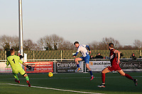 /George Sykes of Aveley beats Laurie Walker of Chelmsford City only for his effort to be cleared off the line during Aveley vs Chelmsford City, Buildbase FA Trophy Football at Parkside on 8th February 2020