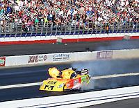 Nov 10, 2013; Pomona, CA, USA; NHRA funny car driver Bob Bode explodes his engine during the Auto Club Finals at Auto Club Raceway at Pomona. Mandatory Credit: Mark J. Rebilas-
