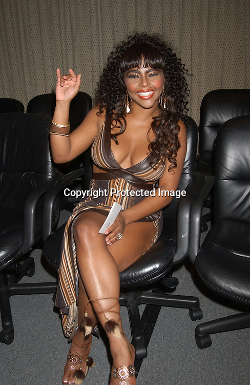 """Lil' Kim in Kimora Lee Simmons Dress                                   ..at """" The Source Magazine's """" announcement of their ..nominees for the Hip Hop Music Awards 2003 at the Millennium Broadway Hotel on August 27, 2003.                   Photo By Robin Platzer, Twin Images"""