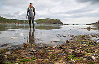 BNPS.co.uk (01202) 558833 <br /> Pic: CorinMesser/BNPS<br /> <br /> WITH VIDEO... https://we.tl/t-pi2ICf3bFT<br /> <br /> Pictured: Oly is training to swim around the Isle of Wight <br /> <br /> This is the terrifying moment a man found himself surrounded by 50 sharks in British waters while training to swim around the Isle of Wight. <br /> <br /> Oly Rush set off from the exclusive Sandbanks resort, Dorset, for his first night time swim in preparation for the charity challenge. <br /> <br /> He cut through the pitch black waters, unable to see more than a few metres ahead of him, until something knocked him about 240ft from shore. <br /> <br /> Stopping alongside Ashley McPherson, who accompanied him in a kayak, unknown creatures continued to buffer at his legs near Branksome Beach, Poole. <br /> <br /> Unnerved, Oly, 36, dived beneath the surface with his phone in a waterproof case while Ashley pointed his torch.