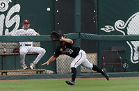 Nebraska outfielder Mojo Hagge (39) forces an out, Monday, June 7, 2021 in the second inning of the NCAA Fayetteville Regional at Baum-Walker Stadium in Fayetteville. Check out nwaonline.com/210608Daily/ for today's photo gallery. <br /> (NWA Democrat-Gazette/Charlie Kaijo)