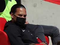 24th April 2021; Anfield, Liverpool, Merseyside, England; English Premier League Football, Liverpool versus Newcastle United; long term injury absentee Virgil van Dijk of Liverpool watches from the lower tier of the main stand