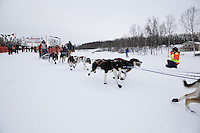 Caleb Miller and dog team leaves the start line of the 2013 Junior Iditarod on Knik Lake.  Knik Alaska..Photo by Jeff Schultz/IditarodPhotos.com   Reproduction prohibited without written permission
