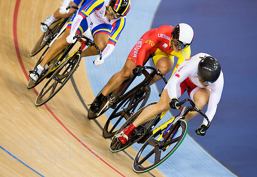 03 AUG 2012 - LONDON, GBR - Guo Shuang (CHN) (right) of China leads Daniela Grelui Larrael (VEN) (left) of Venezuela  and Simona Krupeckaite (LTU) of Lithuania (centre) during the first round of the Women's Keirin at the London 2012 Olympic Games track cycling in the Olympic Park Velodrome in Stratford, London, Great Britain .(PHOTO (C) 2012 NIGEL FARROW)