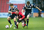 Ross County v St Johnstone....04.01.14   SPFL<br /> Chris Millar is sandwiched between Alex Cooper and Brian McLean<br /> Picture by Graeme Hart.<br /> Copyright Perthshire Picture Agency<br /> Tel: 01738 623350  Mobile: 07990 594431