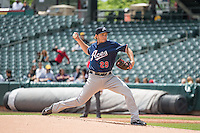 A.J. Schugel (29) of the Reno Aces delivers a pitch to the plate against the Salt Lake Bees in Pacific Coast League action at Smith's Ballpark on May 10, 2015 in Salt Lake City, Utah.  Salt Lake defeated Reno 9-2 in Game One of the double-header. (Stephen Smith/Four Seam Images)