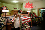 August 25, 2007. Kinston, NC.. A viewing of the coffin of Spc. Steven R. Jewell was held at Howard and Carter Funeral Home i Kinston, NC. Spc. Steven R. Jewell was killed in a helicopter crash near the Iraqi city of Fallujah on August 14, 2007.. Spc. Jewell's son, Will, in camo, salutes at his father's coffin.. .. .