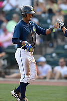 Second baseman Luis Carpio (18) of the Columbia Fireflies is greeted after scoring a run in a game against the Rome Braves on Sunday, July 2, 2017, at Spirit Communications Park in Columbia, South Carolina. Columbia won, 3-2. (Tom Priddy/Four Seam Images)