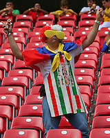 An Italy fan wearing an apron cheers his side on