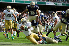 Sept. 1, 2012; Notre Dame running back Theo Riddick rushes to the end zone for a touchdown during the first quarter the 2012 Emerald Isle Classic against Navy at Aviva Stadium in Dublin, Ireland. Photo by Barbara Johnston/University of Notre Dame