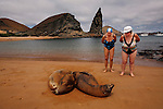 GALAPAGOS - SEPTEMBER 26, 2007: Tourists at Isla Bartolomé watch Sea Lions while visiting Pinnacle Rock in the Galapagos on September 26, 2007 in Ecuador.  (PHOTOGRAPH BY MICHAEL NAGLE)