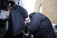 Pictured: Robert Riley (R) is led handcuffed by a custody officer to a waiting prison van after being sentenced by Swansea Magistrates. Thursday 08 May 2014<br />