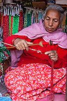 Nepal, Patan.  Woman Making Beaded Necklaces.